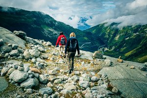 Young Couple Hiking In The Swiss Alps