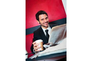 Businessman Having Coffee In A Cafe