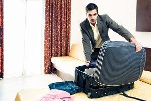 Businessman In Hotel Room