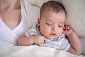 baby sleeps next to mom