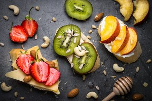Fresh sweet fruit sandwiches on black.