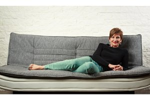 Senior Woman Sitting On Couch