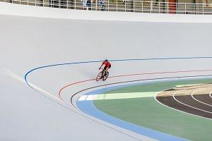 Racing cyclist on velodrome outdoor