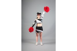 Studio Shot of Cheerleader Posing