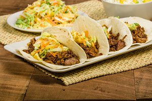 Pork tacos on a white serving plate