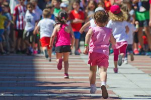 little girl in pink running