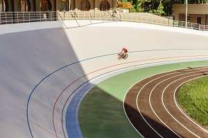 Young professional cyclist on a velodrome