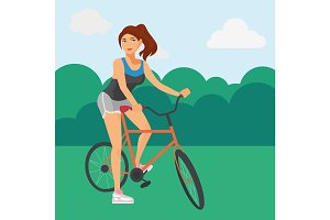 Sportive woman riding a bicycle in the park