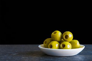 Green pitted olives with olive oil