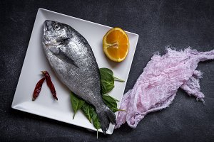 Fresh fish on wooden board