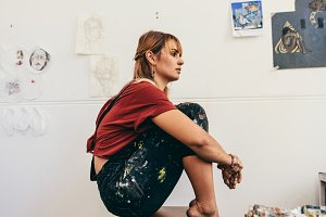 Female artist sitting