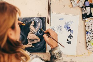 Female artist painting picture