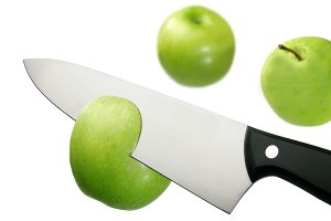 Ktchen knife cutting green apple