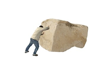 Man casual dress pushing a big rock
