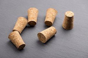 Close-up of corks on blackboard. Horizontal studio shot.