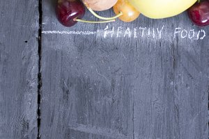 Fruits on rustic background, food background.
