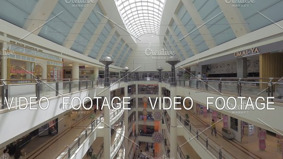 Seen A Big Multi-storey Shopping Centre With Walking People