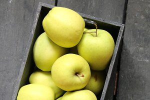 fresh apples on a vintage wooden table