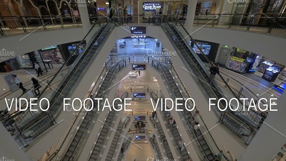 Seen A Big Multi-storey Shopping Centre With Escalators And Walking People