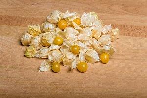 Yellow tomatillos on cutting board