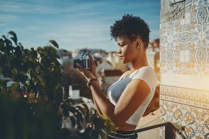 Black girl using vintage camera