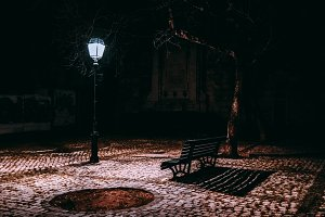Bench and lantern in darkness