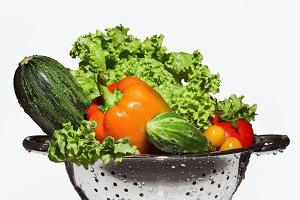 Vegetables in a colander.