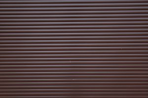 Garage door container stripped texture metal background with horizontal lines.