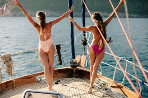 joyful women yachting