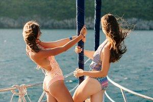 sexy women sail on yacht