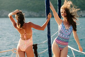 sexy women sail on yacht