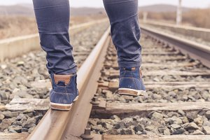 Feet on urban shoes on a railway