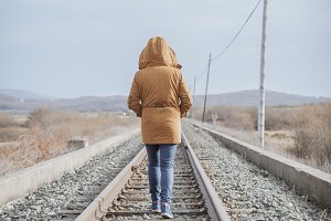 Young woman walking on a railway