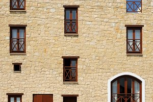 Stone wall house with wooden windows