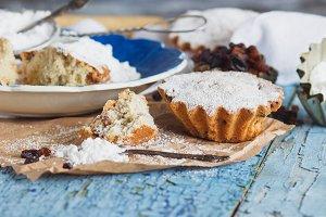 Home-made baking: Cupcakes with raisins and sugar powder