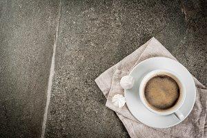 Coffee mug and two meringues