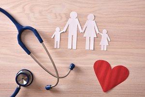Family medicine concept on wood