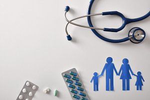 Family medicine concept with pills
