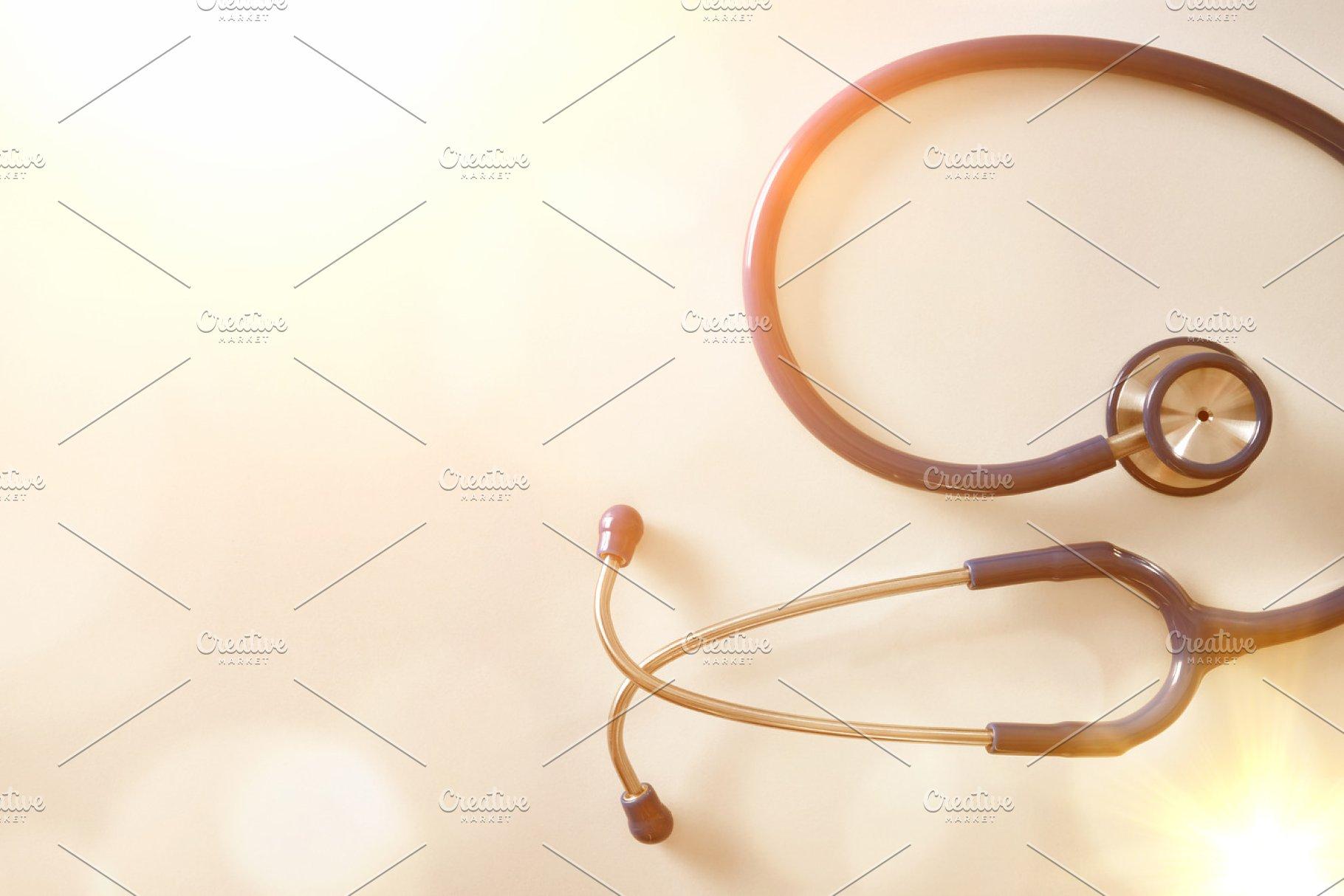 6d29351cfcd8 stethoscope on table golden top ~ Health Photos ~ Creative Market