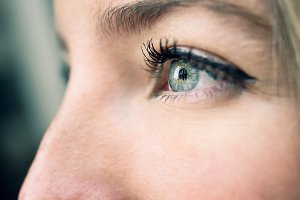 Young woman's eye. Blue color