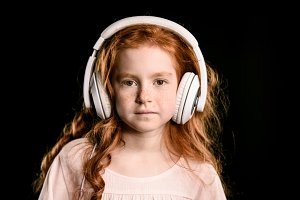 redhead girl listening music