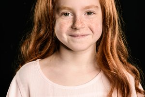 adorable little redhead girl smiling