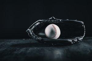 leather baseball glove and ball