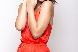 Young fresh girl in red silk pajamas, smile and curls retro pin-up style. Beauty face, body.