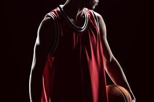 basketball player posing with ball
