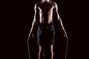 man training with skipping rope