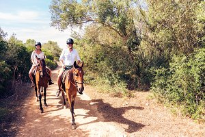 Young Tourist Couple Horseback Riding