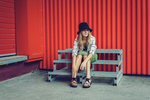 Blond girl in a hat