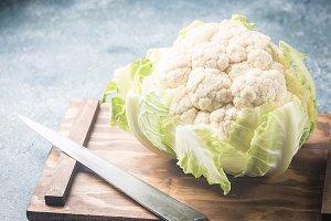 Organic cauliflower on gray background