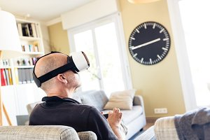 Adult Man Using Vr Goggles At Home